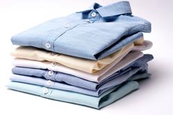 A stack of crisp, folded dress shirts